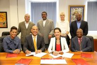 """POND ISLAND--The TelEm Group has signed a US $32 million bond agreement with RBC Merchant Bank (Caribbean) following what the telecoms company said had been months of negotiations. TelEm said it will use the bond issue to finance future capital expenditure and refinance current debt obligations. The bond supplements an eight million euro loan obtained from the European Investment Bank (EIB) in 2015 for a country-wide Fibre-to-the-Home (FTTH) project in St. Maarten. RBC's Vice President Corporate and Investment Banking Andrew Boissiere and TelEm Group Chief Financial Officer (CFO) Helma Etnel said the Bond agreement was officially signed in August 2016 and represents """"a significant achievement for both companies."""" In RBC Merchant Bank's case the bond arrangement entailed delicate negotiations with six major investors, who are together providing the capital necessary for the bond. This is the second time that the TelEm Group has successfully approached the regional capital markets to secure large funding from regional investors, TelEm said in a press release on Thursday. """"I am very grateful to the TelEm Group for its confidence in RBC's ability to deliver on this undertaking and to all of the parties that made this transaction a success, especially the investors, whose proceeds will assist the TelEm Group with achieving its corporate objectives,"""" Boissiere said. """"The RBC Group has maintained a long-standing relationship with the island of St. Maarten highlighted by several large corporate transactions for Princess Juliana [International – Ed.] Airport and [Port St. Maarten – Ed.]. We are very proud to continue this relationship through this Bond issue for the TelEm Group and continue the path of further enhancing the telecommunication infrastructure of the island,"""" he added. """"RBC takes pride in its regional scope, its broad network of institutional partners and international expertize in arranging financing throughout the Caribbean region. It continues to be a leader """